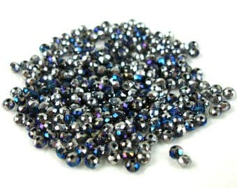 50 silver 4 x 3 mm metallic blue two-tone faceted