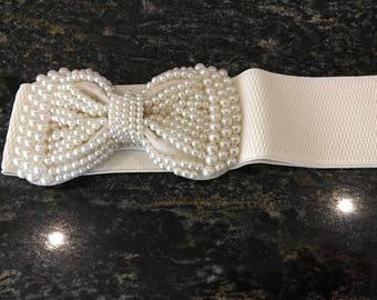 Beaded ivory elastic and bow belt