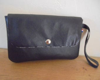 Pocket with leather strap