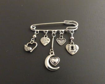 Heart themed silver brooch