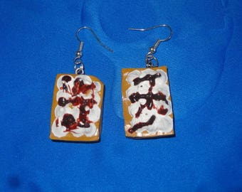 Earrings shaped waffle with chocolate whipped cream