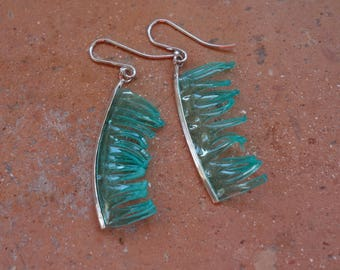 Earrings in 925 sterling silver and recycled material.