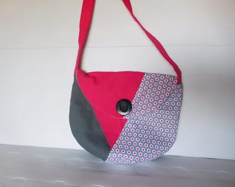 round gray and pink shoulder bag