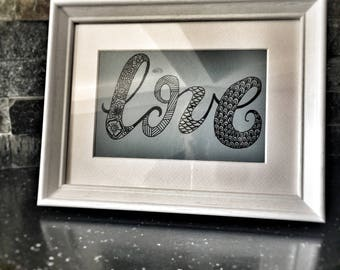 Love written in mandala inspired design
