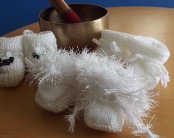Set of three pairs of slippers in white baby wool