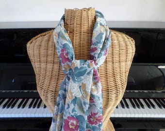 scarf in shades of blue grey with pink flowers