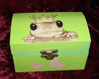 Lime green box frog in a pond