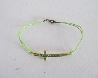 Pretty green rhinestone cross bracelet