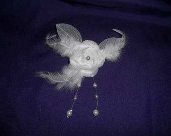 back train, brooch or boutonniere white