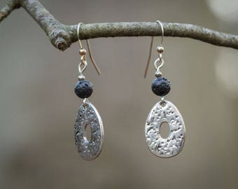 Earrings in hammered silver and lava bead