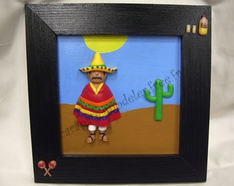 Mexican decorative painting and its multicolored poncho