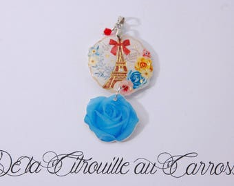 Eiffel Tower pendant and blue flower, red bead