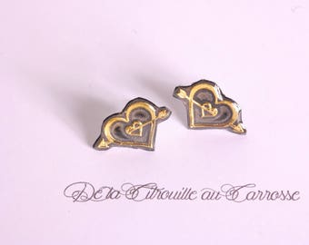 Black and gold heart ear studs