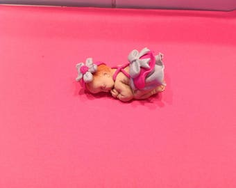 baby polymer clay with a bow