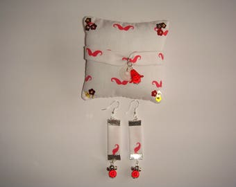 set bracelet earrings support cushion red moustache on white background fabric