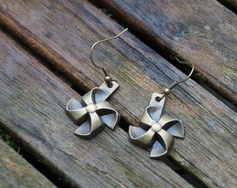 Bronze earrings mill to wind