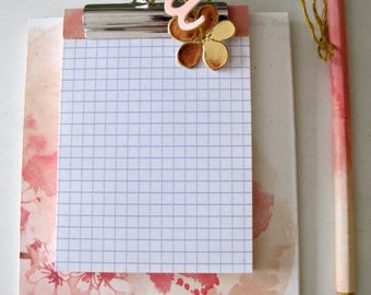 Pink notebook with pencil