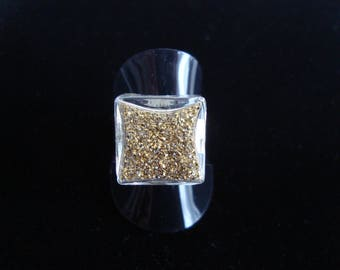 Square glass ring filled with fine gold glitter
