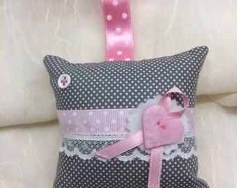 Small decorative cushion or key chain...