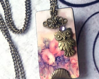 a bouquet of pink flowers brass OWL necklace