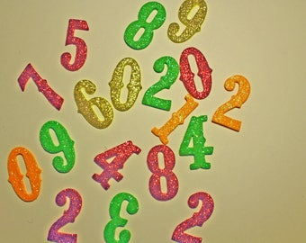 Lot numbers foam candy colors for the advent calendar - gold, fuchsia, green and orange