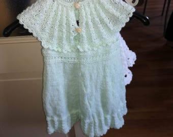 small handmade knitted green dress