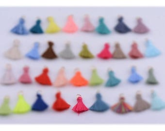 The tassel is pink with golden ring 3cm