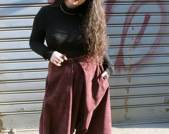 Velvet skirt/trousers with buttons and pockets in the hips