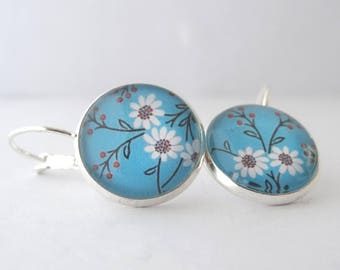 Red background and white flowers earrings blue