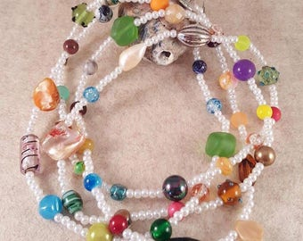 Very long colorful scrap chain * made of glass and wax beads