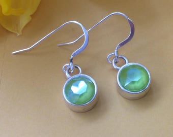 Sterling silver drop earrings with lime  Swarovski crystals in an antique silver charm holder