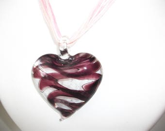Clear and purple glass heart necklace.