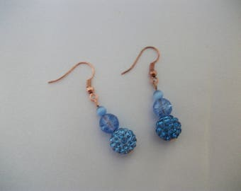 Blue earrings and three beads.