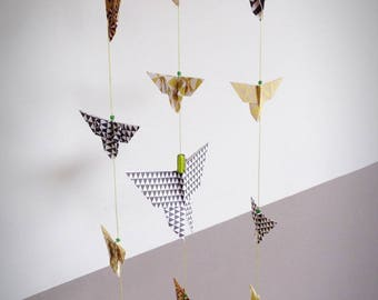 Mobile origami butterflies backed with drift wood