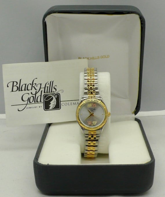 Black Hills Gold Lady's Quartz Two-Tone Stainless Steel Wristwatch Like New in Box by Coleman Jewelry