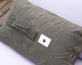 Thick khaki Pillow made with an old military bag