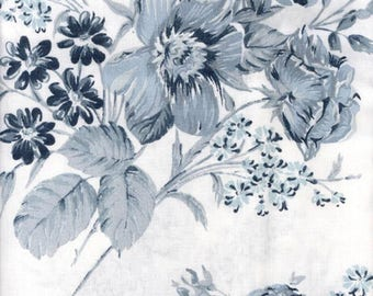 Blue flowers sold oilcloth has cut for making tablecloths