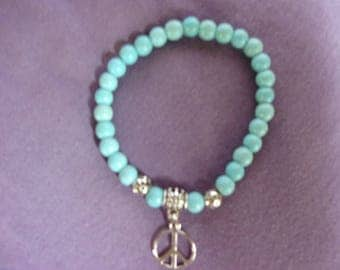Magnesite stretch bracelet with peace sign charm