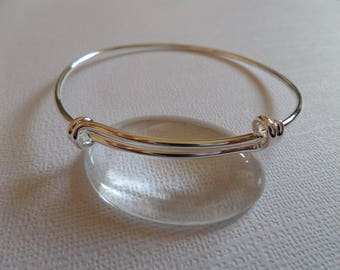 Bangle is adjustable silver color
