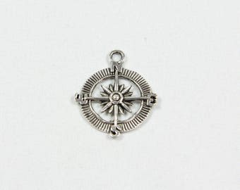 A silver compass pendant charm