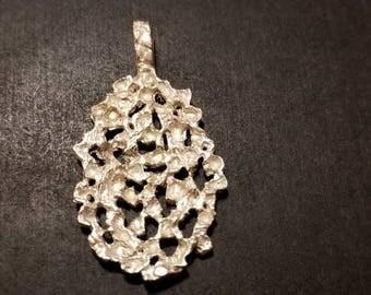 Sterling Silver Oval Faceted Leaf Pendant