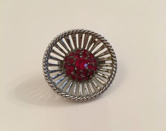 Round vintage silver tone brooch with faux rubies