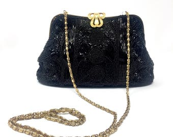 Minaudiere/Vintage evening bag, completely covered with black beads, with golden chain strap