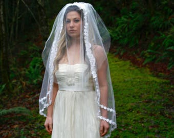 Vintage fingertip length veil with blusher and double floral lace trim