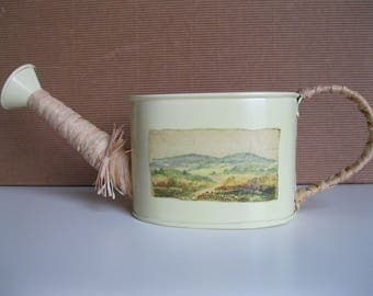 Watering in yellow tin with hilly landscape