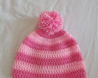 Baby girl hat with pompom