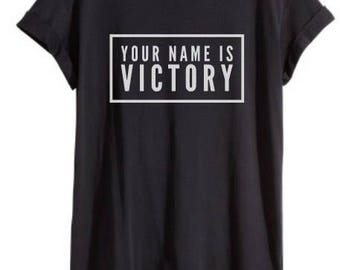 Christian basic tee 'Your name is Victory'