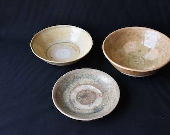 Three celadon ceramic bowls