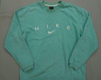 Vintage wmns Nike blue sweatshirt swoosh spell out