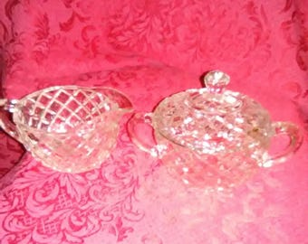 Vintage crystal creamer and sugar bowl with lid. Diamond shaped pattern. This would look great on your dining room table.